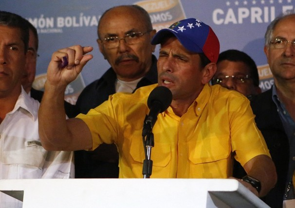 Opposition presidential candidate Henrique Capriles talks to journalists after official results of the presidential elections were announced in Caracas, Venezuela. Capriles is refusing to accept the results of Sunday's presidential election and is demanding a recount. Fernando Llano / AP