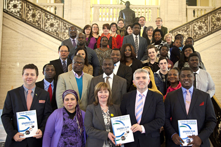 From left Front - Dr Christopher Stange, Hon. Consul for St. Vincent and the Grenadines to Northern Ireland and acting chair ACSONI, Jennifer McCann MLA and Jonathan Bell MLA, OFMdFM Junior Ministers with Officials and Leaders of the National Caribbean and African Associations and Statutory bodies.