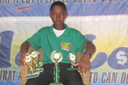 Grenada's Emmanuel Stewart with his trophies.