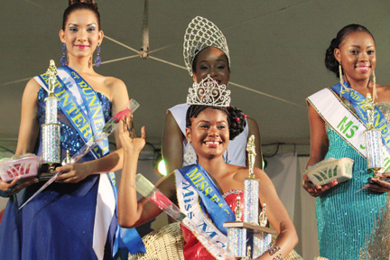 Miss Easterval 2013 Justlyn Ollivierre of Mayreau is flanked by First Runner-up, Miss Barbados, Heidi Barro, left, and Second Runner-up, Miss St. Vincent, Shackell Bobb