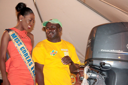 Fisherman of the Year 2013, Lenford Jack, chats with Miss SVG 2013 contestant, Brooke Legair, during the presentation ceremony at Calliaqua on Monday, May 20.