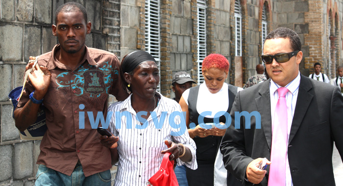 Dwaine Sandy, left, is seen with his mother, Margaret Sandy, and lawyer, Grant Connell, shortly after Sandy was released from police custody on Wednesday, June 19, 2013. (IWN photo)