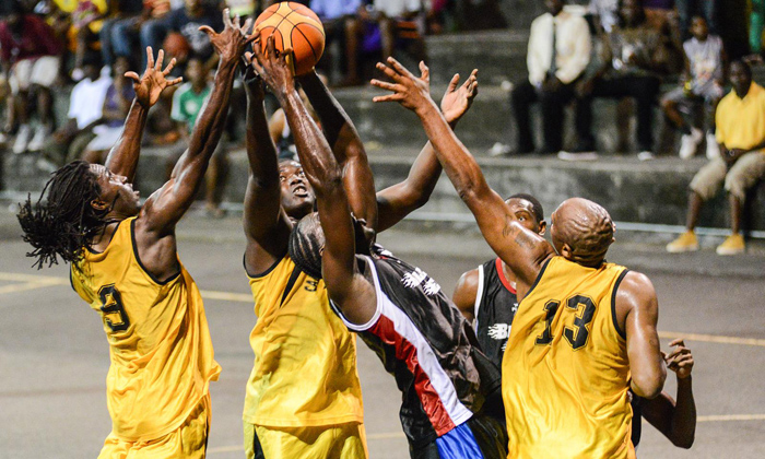 Calliaqua United players defend as Jonas King #8 of Bequia United attempts a basket in the Men's Basketball Championship at the New Montrose Basketball Facility on Sunday. (Photo: Edward Newman)