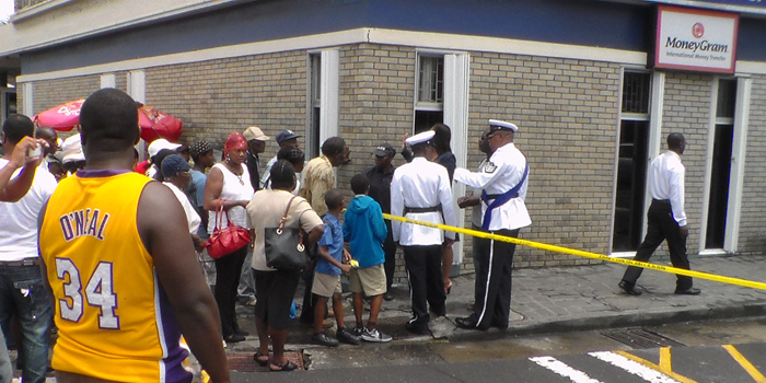 Police officers talk with civilians at the crime scene. (IWN photo)