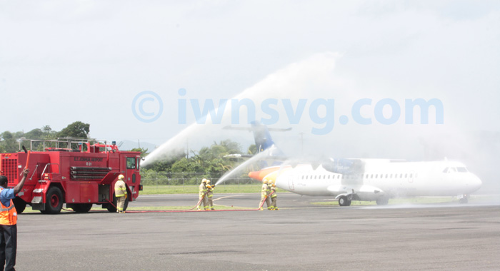 The new LIAT ATR 72-600 gets the traditional water salute on its inaugural flight to St. Vincent on Wednesday, June 26, 2013.