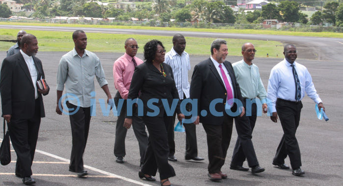 Prime Minister Dr. Ralph Gonsalves (in red tie) leads the welcoming delegation.