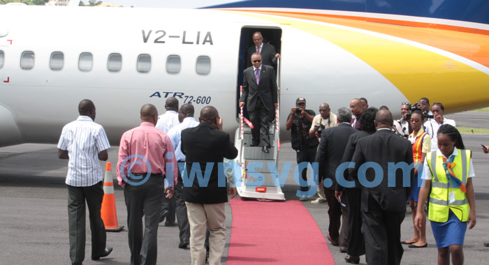 LIAT chairman, Dr. Jean Holder, and CEO, Capt. Ian Brunton disembark the aircraft.