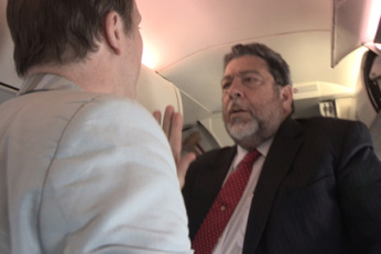 Prime Minister Dr. Ralph Gonsalves reacts to a BBC journalist on board the airplane in Barbados on Sunday, Feb. 17, 2013.