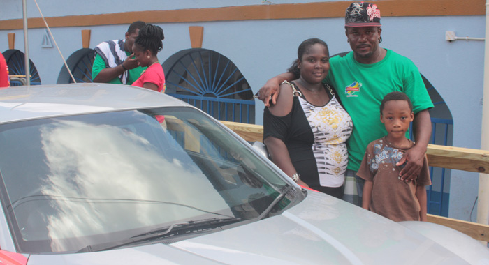 Carlisle Burke poses wit his wife, Loretha Burke and their son, Ceej next to the Mazda RX-8 (IWN photo)