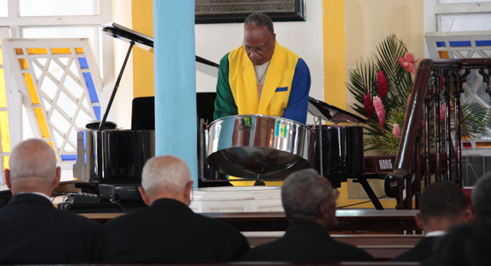 "Musician Ken Isle pays musical tribute to fellow musician Patrick ""Pat"" Prescod during his funeral at the Kingston Methodists Church on Thursday. (IWN photo)"
