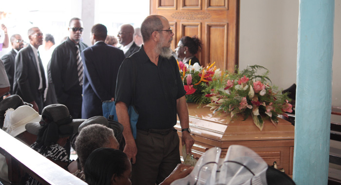 "A mourner passes by the coffin of Patrick ""Pat"" Prescod at the Kingstown Methodist Church on Thursday, July 18th, 2013. Prescod, an accomplished musician, died on July 11, 2013, age 81. He was buried in the church yard.  (IWN photo. click photo for story)"