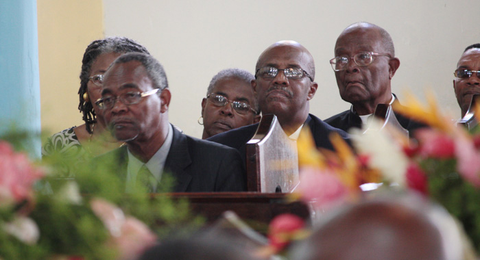"Speaker of the House of Assembly, Hendrick Alexander, left, and Opposition Leader, Arnhim Eustace, centre, among mourners at the funeral of Patrick ""Pat"" Prescod at the Kingstown Methodist Church on Thursday."