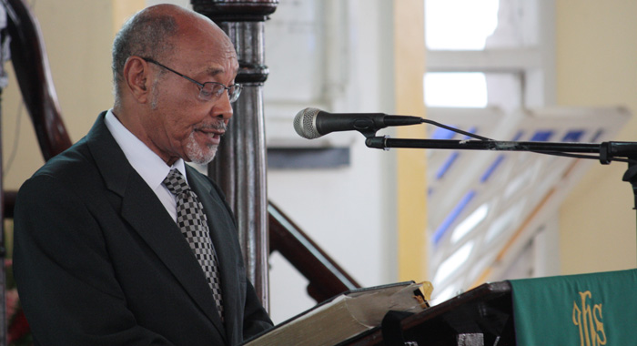 "Dr. Julian Duncan delivers the eulogy at the funeral of Patrick ""Pat"" Prescod at the Kingstown Methodist Church on Thursday. (IWN photo)"