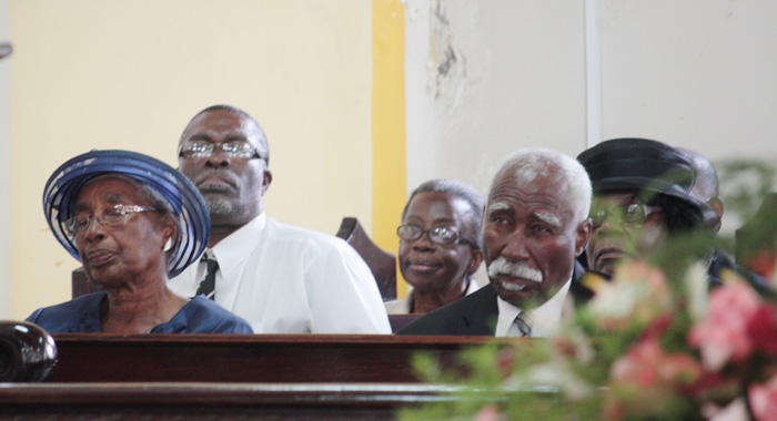 "Governor General Sir Frederick Ballantyne, right, Minister of Health Clayton Burgin, centre, and Governor General's Deputy, Dame Monica Dacon, attend the funeral of Patrick ""Pat"" Prescod."