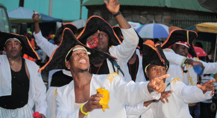 Masqueraders in an all-male section of a band pose for photographers in Kingstown on Tuesday, July 9, 2013. (IWN photo)