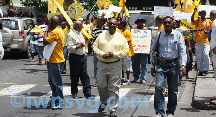 Opposition Leader and New Democratic Party president, Arhnim Eustace, centre, leads the march in Kingstown on Friday.