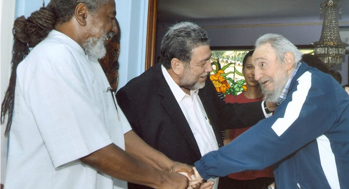 "Vincentian journalist, Duggie ""Nose"" Joseph is introduced to former president of Cuba, Fidel Castro. Prime Minister of St. Vincent and the Grenadines, Dr. Ralph Gonsalves, is at centre."