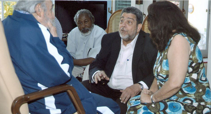 "Vincentian journalist, Duggie ""Nose"" Joseph sits in on a conversation between former president of Cuba, Fidel Castro, and Prime Minister of St. Vincent and the Grenadines, Dr. Ralph Gonsalves in Havana."