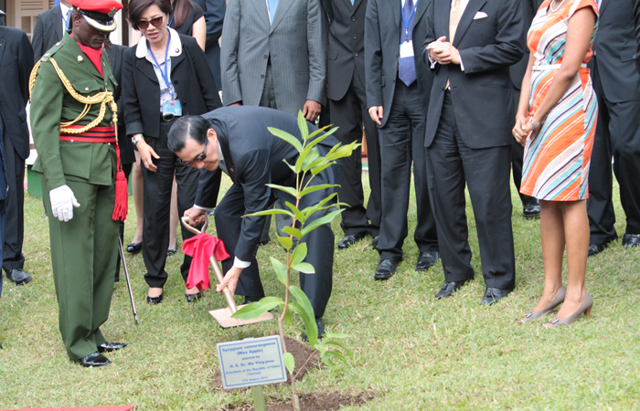 President Ma planted a wax apple tree at the Botanical Gardens in Kingstown. (IWN photo)