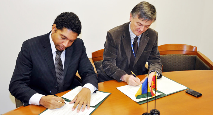 Ambassador Gonsalves, left, and Ambassador Milorad Šćepanović of Montenegro, sign documents  establishing diplomatic ties between SVG and Montenegro on Nov. 8, 2010. (Photo courtesy SVG U.N. Mission).