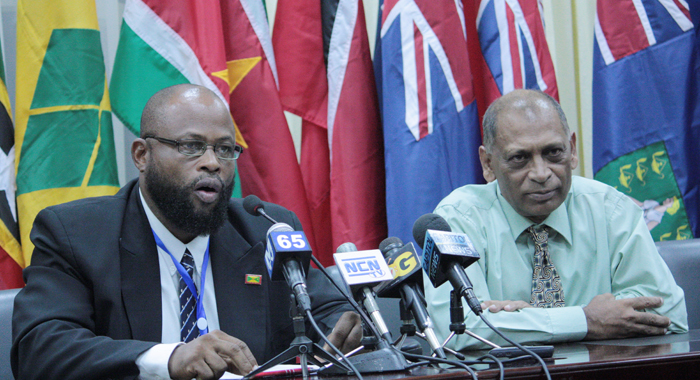 Chair of CARICOM's Council on Trade and Economic Development (COTED) on Agriculture, Roland Boulder, left, and Guyana's Agriculture Minister, Dr. Leslie Ramsammy.