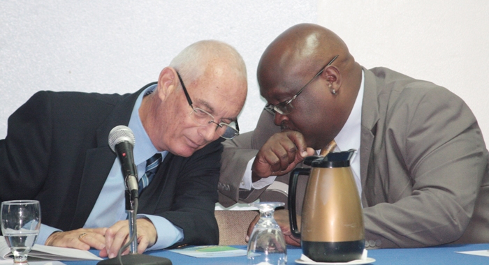 Officer-in-Charge of the CDB's Economic Infrastructure Division, Andrew Dupigny, right, and Brent Bailey, chief engineer, Ministry of Transport and Works at the launching today. (IWN photo)