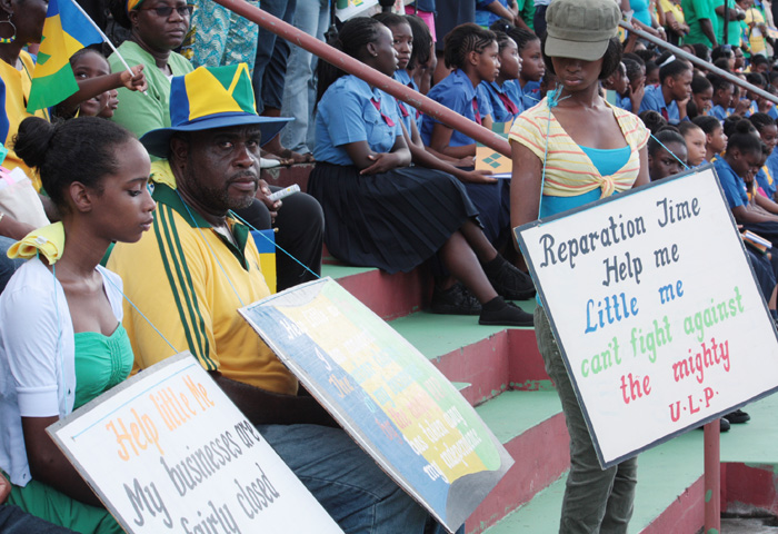 """Businessman Leon """"Bigger Biggs"""" Samuel and his daughter picket during the Independence Parade on Sunday. (IWN photo)"""