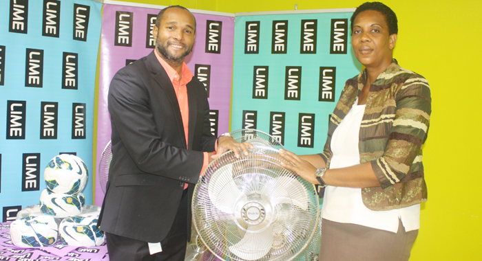 Alexia Charles receives fans from Manager of LIME,, Leslie Jack.