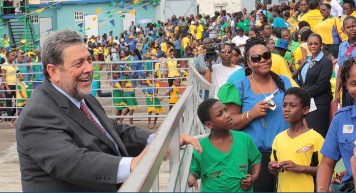 Prime Minister Dr. Ralph Gonsalves chats with spectators after delivering his Independence Address at Victoria Park. (IWN photo)