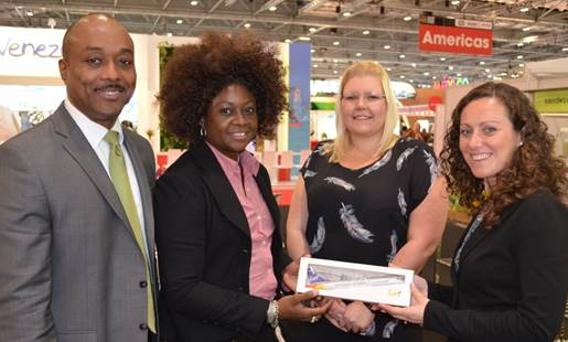 Leesa Parris-Rudder and Deryck Clarke present Kate Leigh, right, and Becci Oaten of Virgin Atlantic with a LIAT memento during World Travel Market in London.