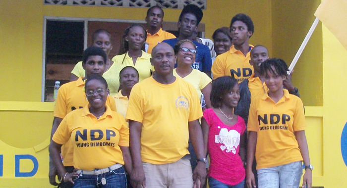 Young Democrats pose with NDP candidate for North Windward, Lauron Baptiste.