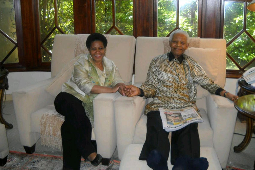 UN Women Executive Director, Phumzile Mlambo-Ngcuka sitting with Nelson Mandela. (Photo: UN Women/Noah Selowe)