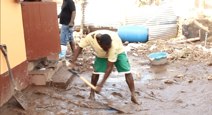 Residents of Buccament Bay had begun to clean up on Thursday. (IWN image)
