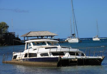 A partly submerged yacht at Canash Bay. (IWN file photo)