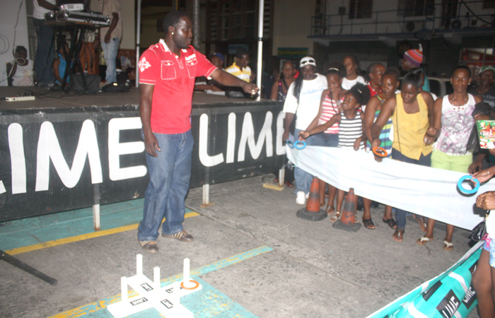 Persons enjoy the ring toss game at the Lime promenade.