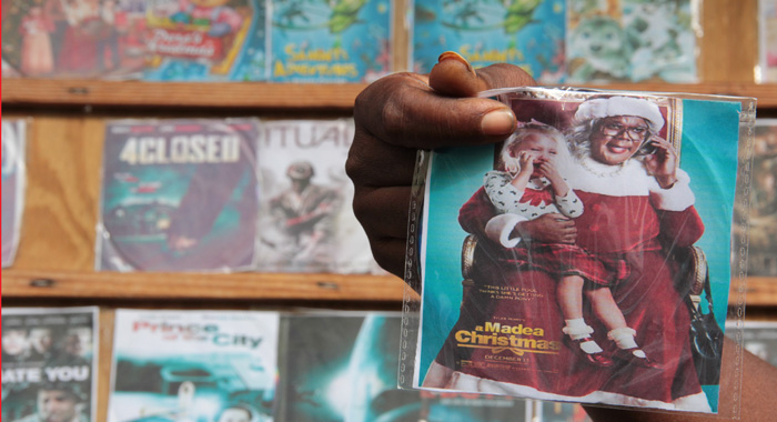 Bootlegged copies of A Madea Christmas and other films are offered for sale in Middle Street, Kingstown. (IWN photo)
