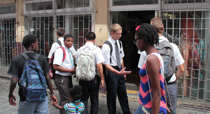 Missionaries from the Church of Jesus Christ of Latter-Day Saints chat in Middle Street, Kingstown on Christmas Eve. (IWN photo)