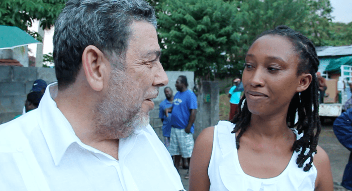 Prime Minister Ralph Gonsalves and a disaster victim in Buccament Bay on Friday. (IWN image)