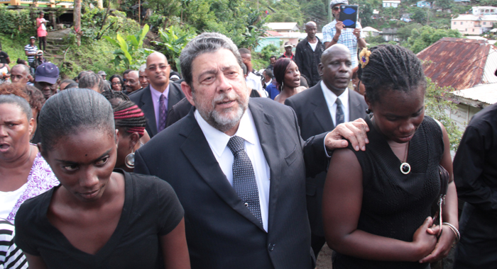 Prime Minister Ralph Gonsalves, centre, during the funeral procession. (IWN photo)