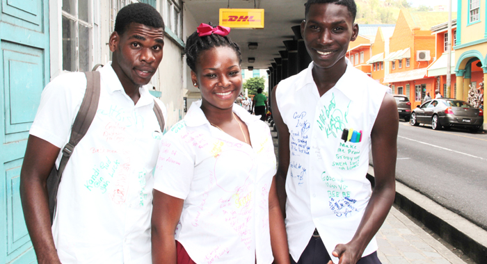 ON STUDY LEAVE: Three Form 5 students from the Petit Bordel Secondary School wear modified and autographed uniforms in Kingstown on Friday, April 25, 2014, the last day of class ahead of the 2014 school-leaving examinations. (IWN photo)