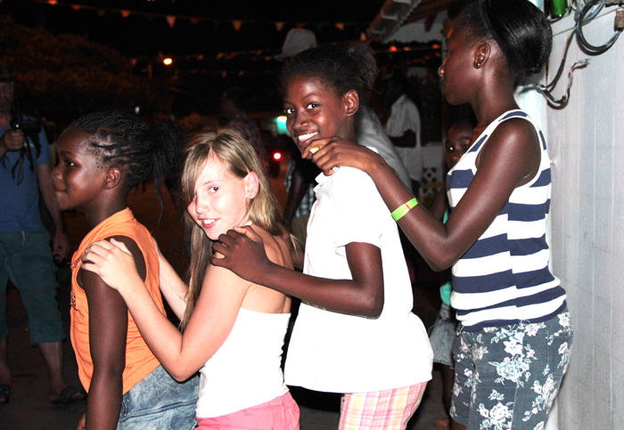 A visiting child and local children dance together in Clifton, Union Island Sunday night. Easterval is a significant income generator on the Southern Grenadines island. (IWN photo)