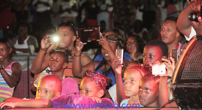 DIGITAL GENERATION: Patrons at the climax of Gospel Fest 2014, including children, use digital devices to capture various elements of the show at Victoria Park on Sunday, April 27, 2014. (IWN photo)