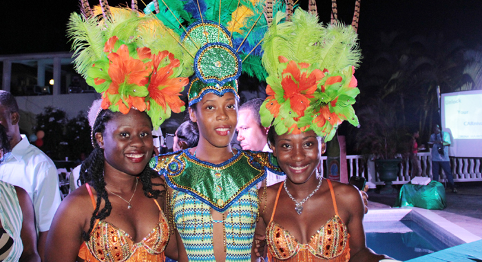 MASQUERADING MODELS: Three models pose at an event in Kingstown on Tuesday, April 29, 2014, where the St. Vincent Brewery Ltd. announced it Vincy Mas 2014 promotions and sponsorships of various elements of Carnival. The company will this year give away a BMW -- the second consecutive year that a vehicle is part of the promotion -- but is yet to announce the details. (IWN photo)