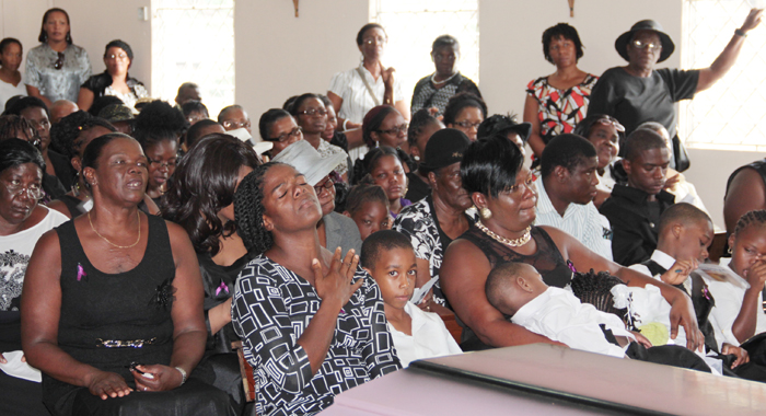 Miranda Williams' mother, Monica Williams, left, her sisters and other relatives, among mourners at her funeral in Rillan Hill on Saturday. (IWN photo)