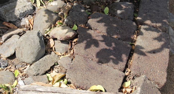 Blood stains can be seen on these bricks outside the house in Biabou. (IWN photo)