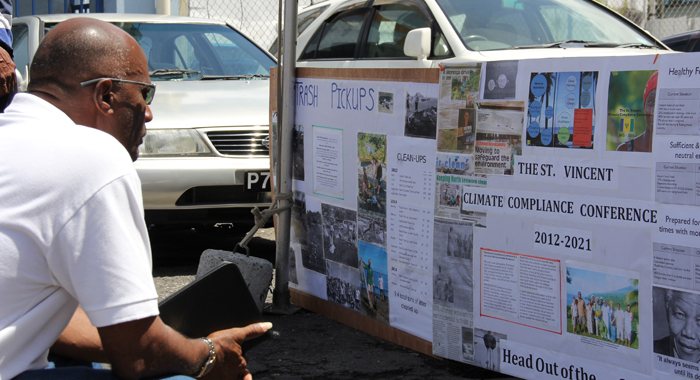 A man looks at a biodiversity display in Kingstown. Click for more photos. (IWN photo)