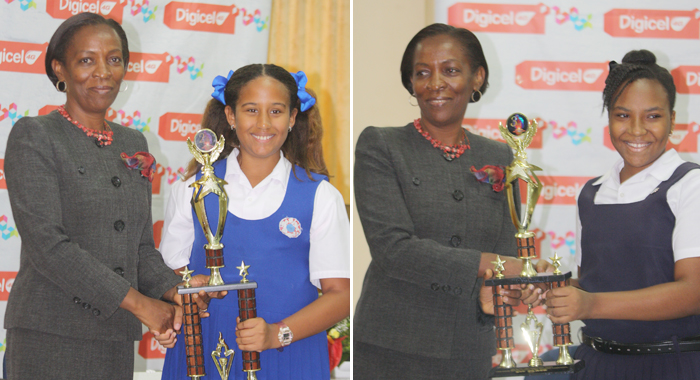 Second place winner, Kayla Ballantyne of Winsor Primary School (left image), and third place winner, Mikayla Friday of Kingstown Preparatory School, receive trophies from Chief Nutritionist Patsy Wyllie.