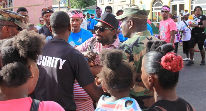 Police intervene as a situation developed in a T-shirt band on Monday. The CDC has praised the vigilance of the police during Vincy Mas. (IWN photo)