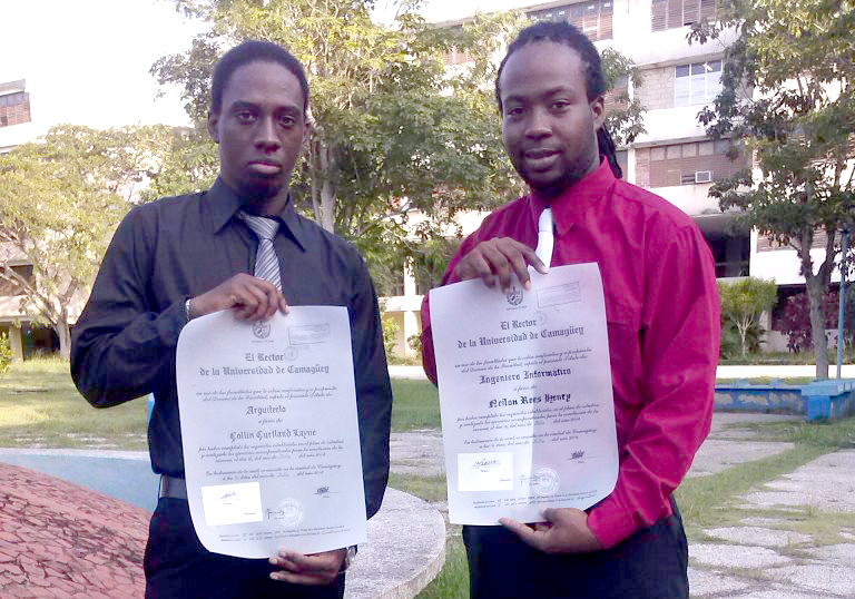 Neilon Henry And Colin Layne Show Off Their Licenciatura Diplomas After Five Years' Architecture And Informatics Studies.