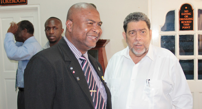 Teachers' Union President, Oswald Robinson, left, and Prime Minister Ralph Gonsalves. (IWN file photo)